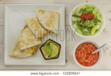 Mexican quesadillas with chicken green beans salad and salsa