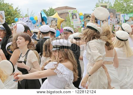STOCKHOLM SWEDEN - JUN 10 2015: Group of happy teenages wearing graduation caps celebrating the graduation after finishing high school at the school Globala gymnasiet June 10 2015 Stockholm Sweden