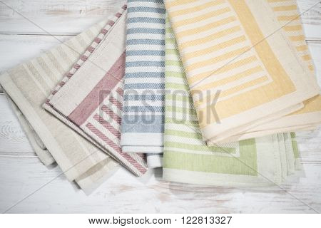 Folded Table Napkins With Woven Stripe Designs Of Various Colors