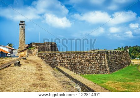 Old Clock Tower At Galle Dutch Fort 17th Centurys Ruined Dutch Castle That Is Unesco Listed As A World Heritage Site  in Galle, Sri Lanka.