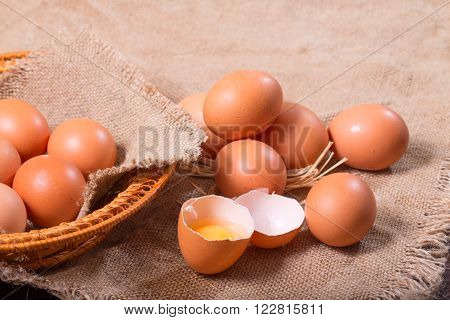 Eggs on a sacking. One egg is broken rural style a close up