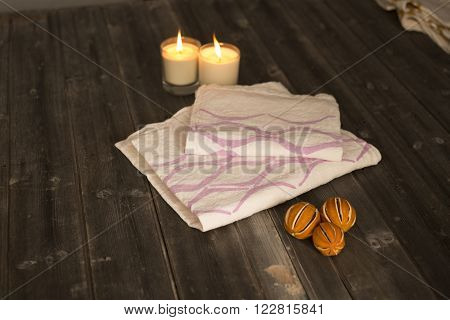 Folded Towel And Napkin With Purple Concave Line Design