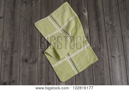 Green Cloth Towel With White And Dark Blue Intersecting Bands