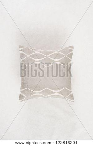 Square Gray Throw Pillow On A White Backdrop