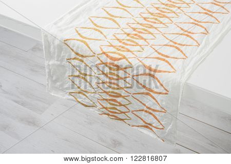 White Towel With Orange Concave Line Pattern On White Counter