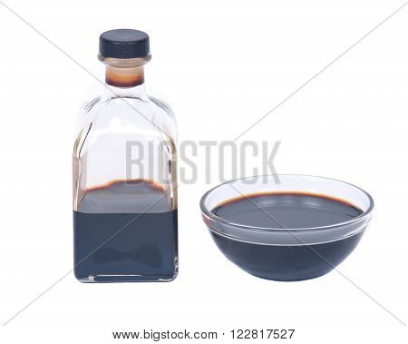 Balsamic vinegar in bowl separated on white background