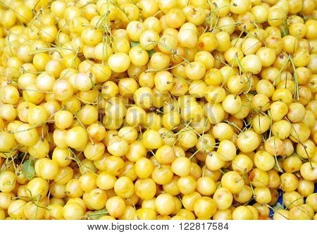 Yellow ripe cherries for background, close up