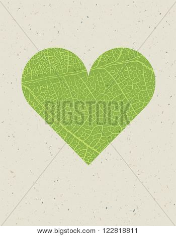 Heart shape with green leaf texture. Nature background with free space for text or image. Green leaf veins texture heart shaped on the recycled paper texture.