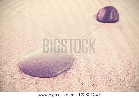 Vintage Toned Stones On Sand, Natural Background, Shallow Depth Of Field