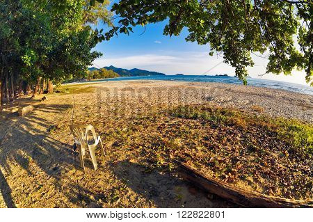 fisheye view on beach and tropical sea under blue sky