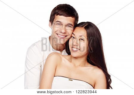 Portrait of young lovely interracial couple, hispanic man and asian girl, hugging and smiling attractive healthy toothy smile isolated on white background - relationship or dental care concept
