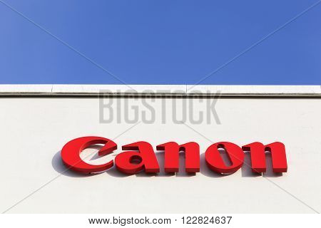 Aarhus, Denmark - February 14, 2016: Canon logo on a facade. Canon is a Japanese multinational corporation specialized in the manufacture of imaging and optical products