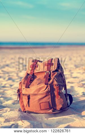Travel Backpack on Summer Sea Beach. Retro styled.