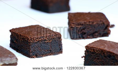 Chocolate Cakes: Very Black Chocolate Brownies On A White Plate