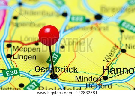 Photo of pinned Osnabruck a map of Germany. May be used as illustration for traveling theme.