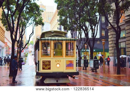 March 2, 2016 in San Francisco, CA:  Historic Cable Car which is a National Historical Moving Landmark where tourists can ride on taken at Union Square in San Francisco, CA during a rain storm