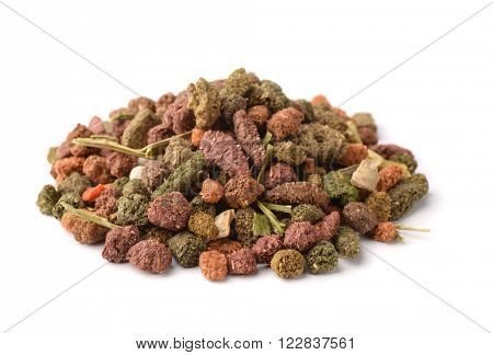 Pile of complete rodents feed isolated on white