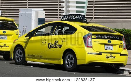 LONG BEACH CA/USA - MARCH 19 2016: California Yellow Cab taxi exterior and logo. California Yellow Cab is a cab company in California.