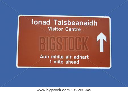 Bilingual visitor centre sign in English and Gaelic in Scotland