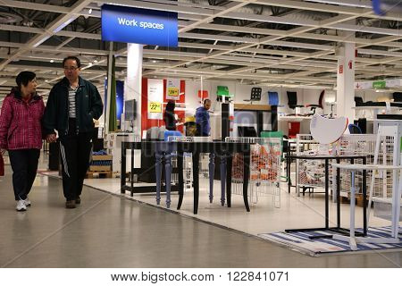 Coquitlam BC, Canada - April 28, 2015 : People shopping inside Ikea store. IKEA was founded in of Sweden in 1943, IKEA to have large chain stores around the world