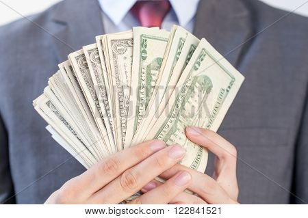 Businessman Holding Bank Notes In White Isolated Background