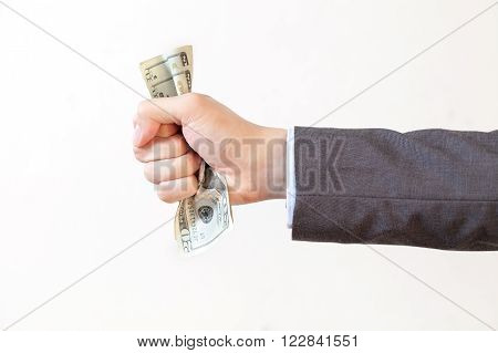 Businessman Squeezing Bank Notes In White Isolated