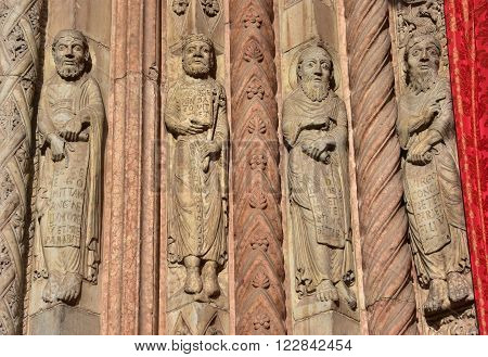 Medieval relief from Verona Cathedral romanesque portal with four saints and prophets created by sculptor Nicholaus in 12th century