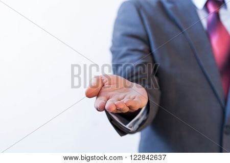 Businessman presenting something on white isolated background