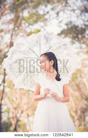 Portrait of mixed-race girl with lace umbrella
