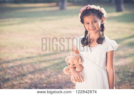 Portrait of smiling preteen girl standing on sunny meadow