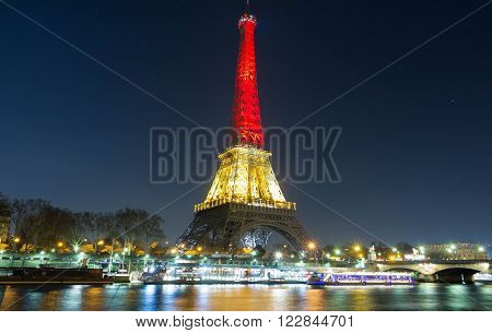 Paris, France - March 22 2016 : The Eiffel tower lit up with the colors of National Belgian flag.