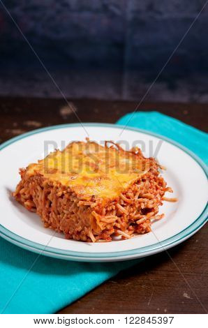 baked spaghetti with crusted gooey cheese and tomato