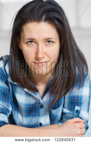 Portrait of young confident female wearing blue checkered shirt, causal look