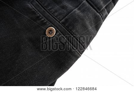 Close up part of black jeans pocket, button focus, isolated on white background