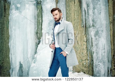 Outdoor Portrait Of Handsome Man In Gray Coat