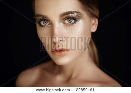 Beautiful woman face. Perfect makeup. Beauty fashion. Eyelashes. Lips. Cosmetic Eyeshadow. Make-up detail. Eyeliner