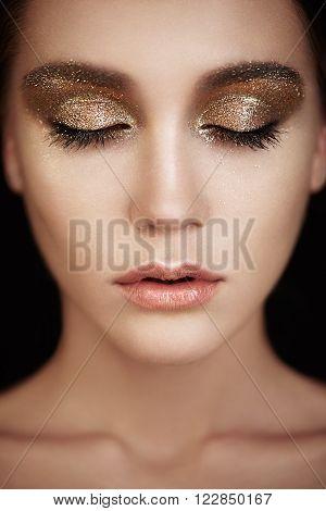 Beautiful woman face. Perfect makeup. Beauty fashion. Eyelashes. Lips. Cosmetic Eyeshadow. Make-up detail. Eyeliner