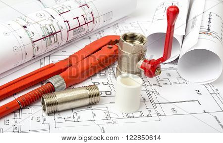 Architecture plan with red turn-screw and mixer tap. Building concept