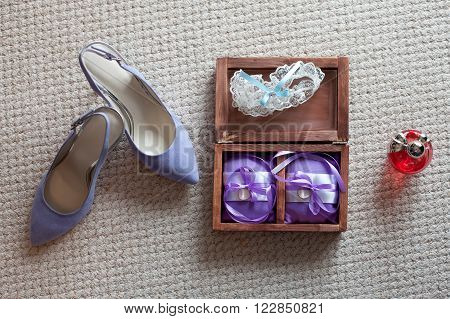 Rings, garter, perfume and shoes - bridal accessories