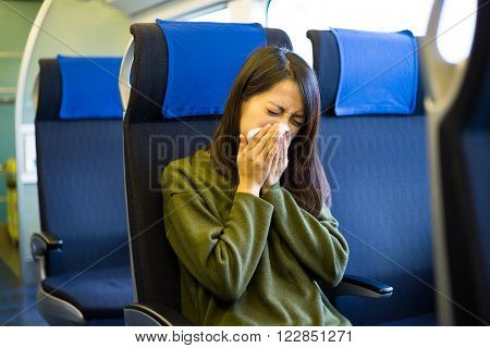 Woman feeling unwell on train compartment