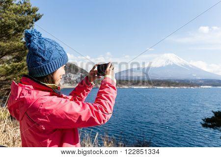 Woman take photo on mountain Fuji