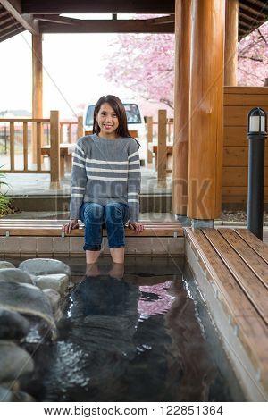 Woman enjoy onsen on foot