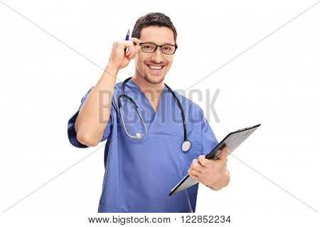 Studio shot of a young doctor holding a clipboard and adjusting his glasses isolated on white background