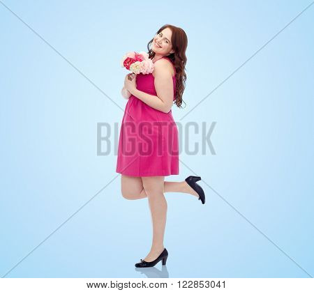 holidays and people concept - smiling happy young plus size woman with flower bunch posing in pink dress over blue background