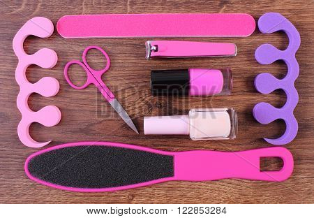 Cosmetics and accessories for manicure or pedicure, nail file, scraper, nail polish, scissors, nail clippers, pedicure separators, concept of nail, hand and foot care