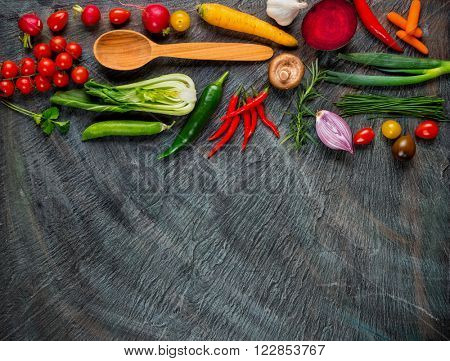 Collection of fresh vegetables placed on black stone with free space for text