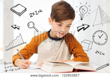 education, childhood, people, homework and school concept - student boy with book writing to notebook at home over mathematical doodles