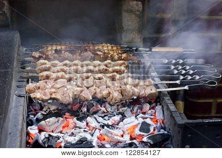 the shish kebab which is fried on coals in a brazier