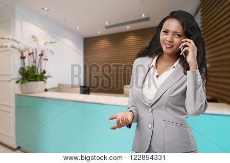 Pretty Malagasy receptionist calling on the phone