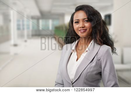 Portrait of young Malagasy business lady  smiling and looking at camera